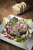 picture of chicory  - Salad plate with tuna lollo rosso chicory tomatoes onionsand vinaigrette - JPG