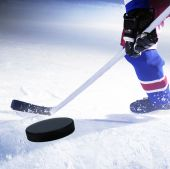 image of ice hockey goal  - ice hockey goal with puck flying towards goal - JPG
