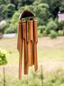 foto of windchime  - Bamboo wind chimes hung outside - JPG