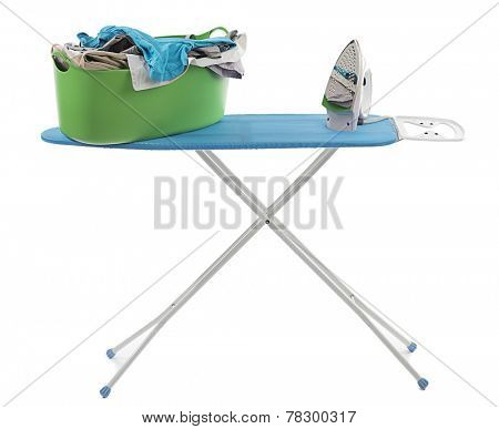 Iron and laundry basket on ironing board isolated on white background.