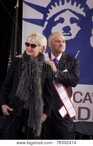 NEW YORK - NOV 11, 2014: Grand Marshall Raymond Kelly, former NYC Police Commissioner and USMC Vietnam War veteran, stands next to his wife Veronica during the 2014 America's Parade on Veterans Day.