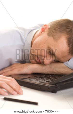 Man Asleep With Laptop