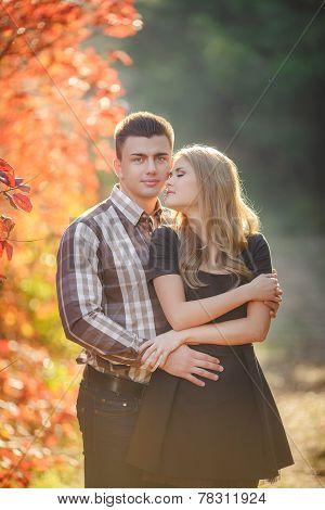 Autumn portrait of a loving couple.
