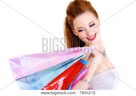 Happy Joyful Woman With Purchases In Hands