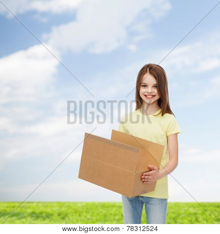 advertising, childhood, delivery, mail and people - smiling little girl holding open cardboard box over natural background