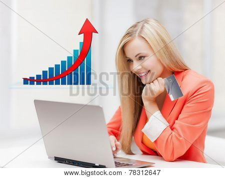 online shopping, finances, people and technology concept - smiling young woman with laptop computer, credit card and growth chart