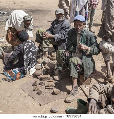 OROMIA, ETHIOPIA-NOVEMBER 5, 2014: Unidentified men sell dried manure for cooking fuel in Ethiopia.