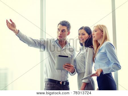 business and office concept - smiling business team working with tablet pcs in office