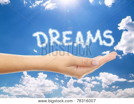Dreams word clouds shape form on hand