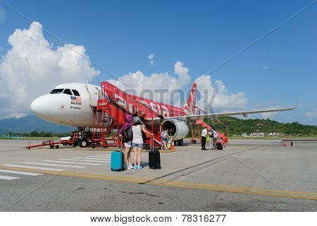 LANGKAWI - MAY 01: Airasia jet flight on May 01, 2014 in Langkawi, Malaysia. AirAsia Berhad is a Malaysian low-cost airline headquartered in Kuala Lumpur, Malaysia