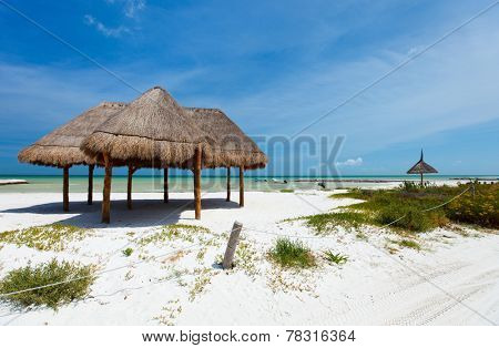 Umbrellas on stunning tropical beach at Holbox Mexico