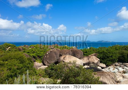 Above view of the Baths beach area major tourist attraction at Virgin Gorda, British Virgin Islands with turquoise water and huge granite boulders
