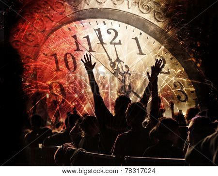 New Year concept - cheering crowd, clock close to midnight and fireworks