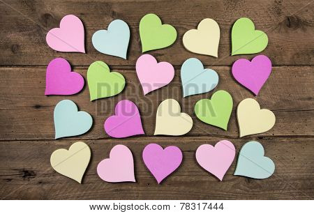 Collection on many colorful hearts on wooden background for love concepts.