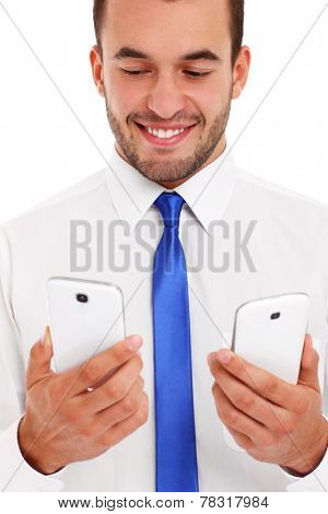 A picture of a businessman with two smartphones over white background