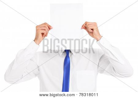 A picture of a businessman covering his face with a paper