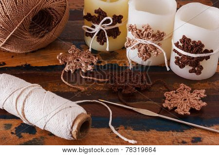 Christmas Decoration Of Candle With Handmade Brown Crochet Snowflakes