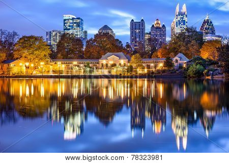Atlanta, Georgia, USA downtown city skyline at Piedmont Park's Lake Meer.