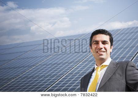 Businessman And Solar Panels