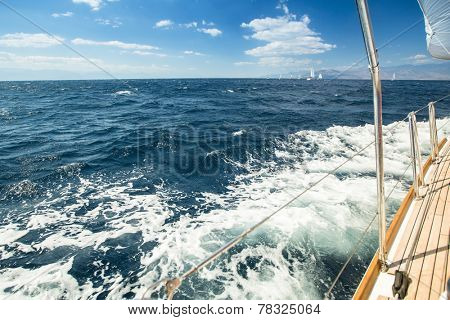 Sailboats participate in sailing regatta. Luxury Yachts. Picture with space for text.