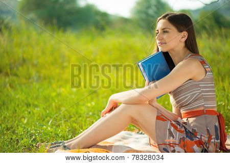 Beautiful Young Girl With Book At Wonderful Green Meadow