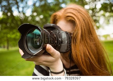 Close up of female photographer at the park