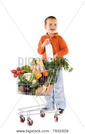Little Boy With Basic Healthy Food In Shopping Cart