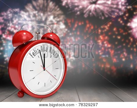 Feliz ano nuevo in red alarm clock against wooden planks