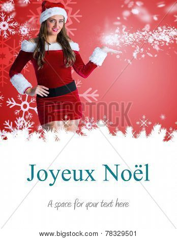 pretty girl in santa costume holding hand out against joyeux noel