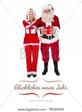 Santa and Mrs Claus smiling at camera offering gift against border