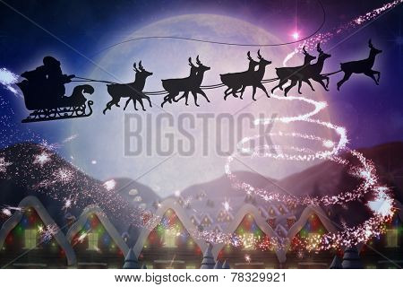 Silhouette of santa and reindeer against quaint town with bright moon
