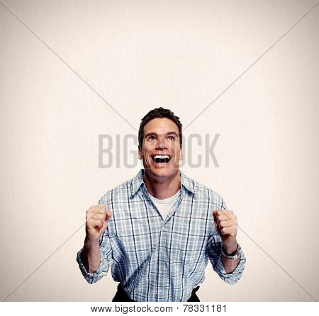 Happy young  man portrait over grey background