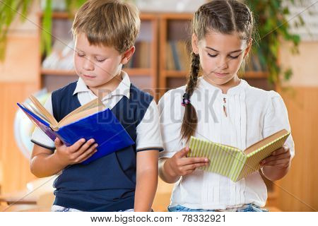 Portrait Of Two Diligent Pupil With Books