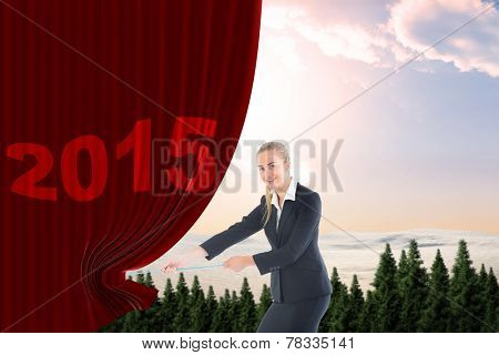 Businesswoman pulling a rope against fir tree forest in snowy land
