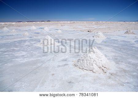 Salt desert with pyramids of salt in Salar de Uyuni