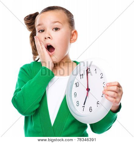 Cute Girl Is Holding Big Clock