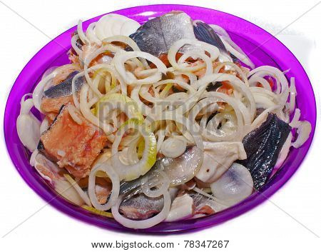 Appetizer of red fish salmon, fish festive dish with onion.