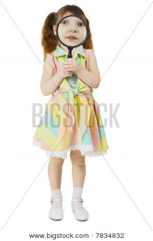 Little Girl Looks At You Through Large Magnifying Glass