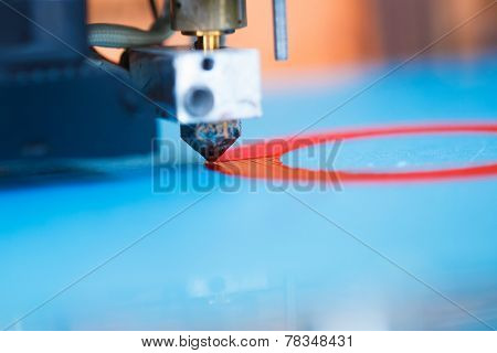 head of 3d printer in action, macro view