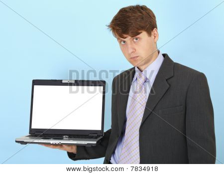 Serious Businessman Holds On Hand Laptop