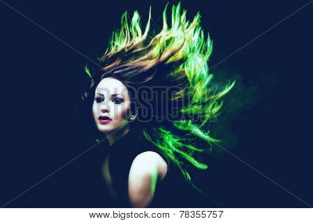 young woman dancing hair in motion green back light