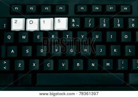 white keys forming the number 2015, as the new year, in a black keyboard