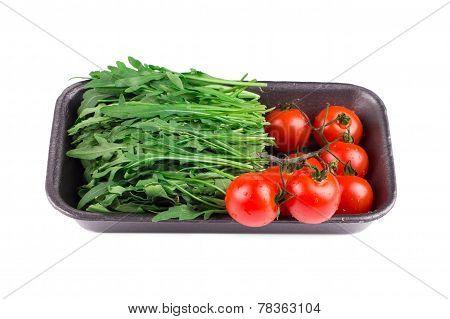 Fresh arugula and tomatoes.