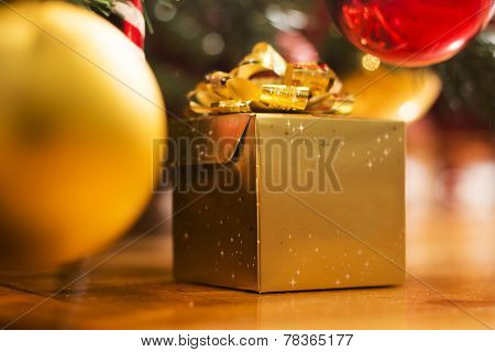 Golden Gift Box Under The Tree