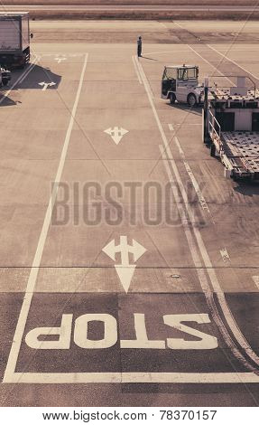 Stop sign on Road at Airport Runway with Truck