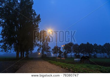 Night Landscape Of A Lonely Road Through The  Countryside
