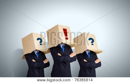 Unrecognizable business people wearing carton boxes on head
