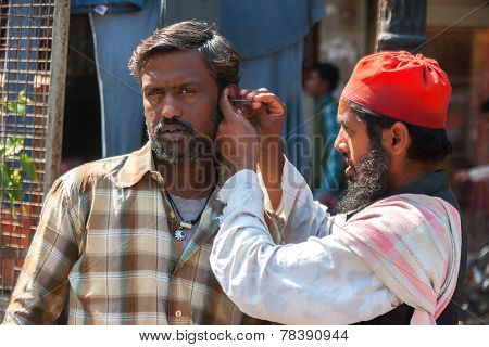 Ear Cleaning On The Streets Of Delhi.