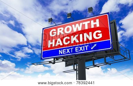 Growth Hacking Inscription on Red Billboard.
