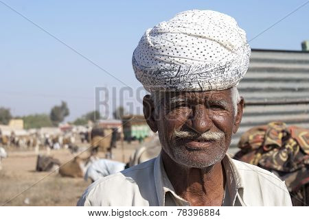 Closeup Of Older Farmer With White Turban.